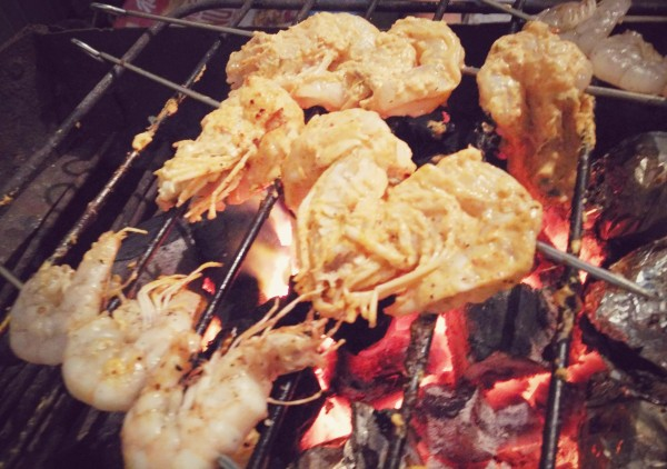 prawns being barbecued on hot coals